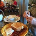 Husband's oatmeal, egg, toast and bacon.