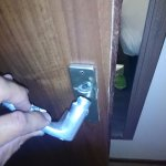 door knob broken, tried to be fixed with tape