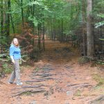 My wife patiently letting me take her picture along the trail at Wiessner Woods.