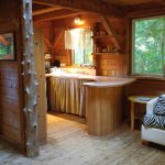 View from the dining table to the kitchen with the hide-a-bed.