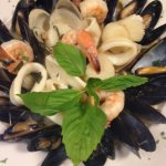 Linguine served with mussels, shrimp, calamari, clams, and scallops