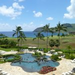 View from the lanai shows pool, golf course, ocean