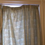 curtains hanging off!