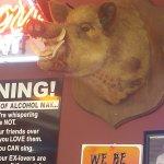 pig on wall inside restaurant