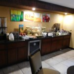 Breakfast area - cereals, bakery items and waffle machine