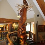 Beautiful carved tree trunk graces the lobby/sitting area