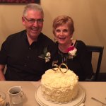 50th anniversary couple, with anniversary cake.