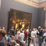 People gathered in front of Rembrandt's Nightwatch