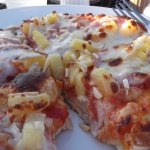 Pizza with pineapple and almond slices. Delicious!!