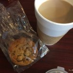 Latte and fresh chocolate chip cookie