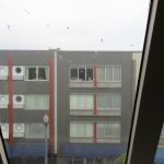 Zephr Hotel as viewed through single glazed, dormer window splattered with bird poo....