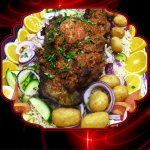 Leg of lamb on bed of rice and roast patatoes