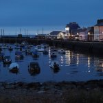 The hotel accross the harbour at evening