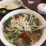 Pho w/well-cooked beef, bean sprouts, jalapeño slices & chili paste