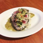 Sesame seared tuna with coconut rice and a mint pineapple sauce.