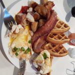 Waffles, eggs, hash browns and bacon
