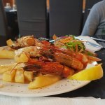 Some delicious seafood, sticky bourbon ribs and fabulous starters of camembert,  prawns and stic