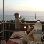 Having a family evening meal and watching ge sunset, beautiful.