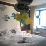 "A wonderful surprise balloon arrangement and ""bride and ""groom"" pillowcases!"