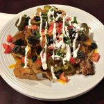 Irish Nachos (add pork belly) Thick sliced potato chips with a generous portion of nacho topping