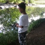 My son on his own fishing in the lake at Prospect Park
