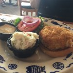 Crab cake sandwich and tarter sauce, broiled