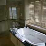 Lovely bubble tub, shower and beyond the privacy shutters, spectacular mountain views