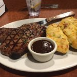 Bone in New York steak with double baked potatoes