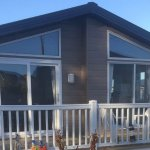 The lodge showing decking and patio doors