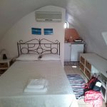 Room, note traditional vaulting and small kitchenette. Modern bathroom at back.
