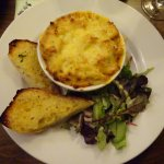 Macaroni Cheese, Garlic Bread and Dressed Leaves.