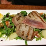 Rare tuna steaks with salad Nicoise