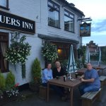 A couple drinks outside overlooking the village green before our evening meal.