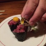 ribeye nigirl with quail egg being added