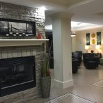 Nice fireplace that is visible on both sides of lobby