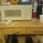 "Our ""kitchenette"". No stove, no sink, no table…just gross Microwave & toaster"