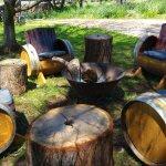 barrel seating around firepit outside celler door.