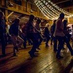 Line dancing during a summer barn dance.
