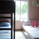 Our Beach View Quad Room (4-5pax) with private bathroom, Cable TV & air-conditioning