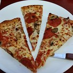 """The slices are cut a little """"different"""" this is 3 slices from a Large Pizza."""