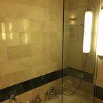 Shower over bath tub.