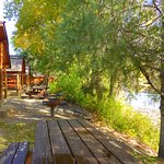 Most cabins have a table on the deck, a grill nearby, and are on the river.