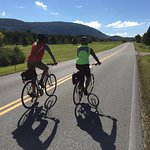 Cycling along a quiet road on the shoulder of Vermont's Green Mountains (Champlain Valley).