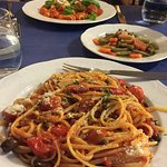 Linguine pasta with olives, garlic and tomato