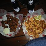 steamed shrimp with side of hushpuppies, beer