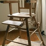 Vintage high chair on the half landing.