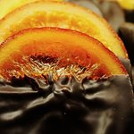 Candied orange, dipped in chocolate.