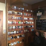 Wall of coffee cups in lobby