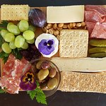 Enjoy a delectable cheese and charcuterie plate with your wine