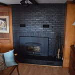 Fireplace in small bedroom, Hither Cottage.